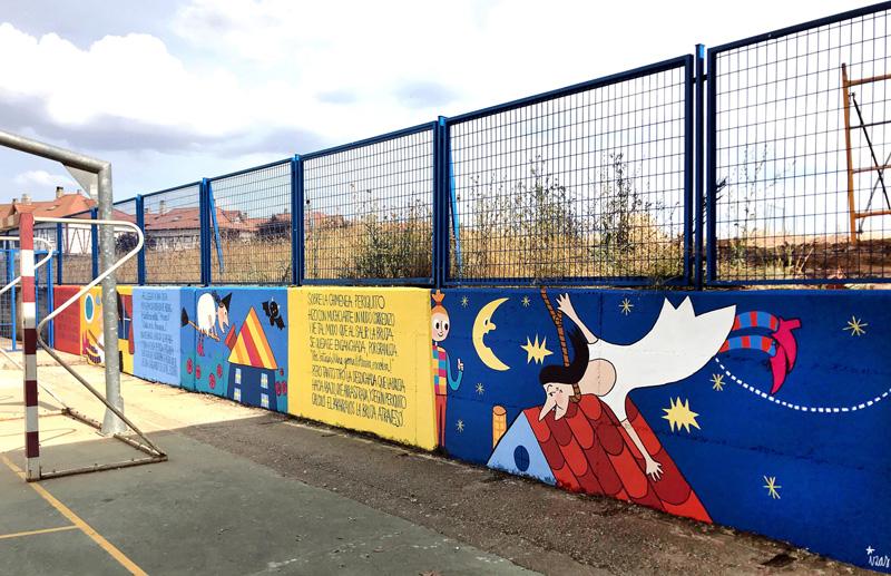 mural azulpatio izas dibujando la palabra ceip gloria fuertes pano 1