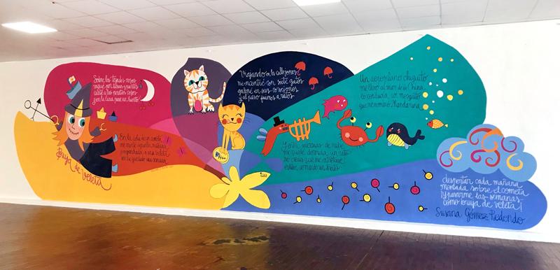 mural izas azulpatio dibujando la palabra ágreda dcha