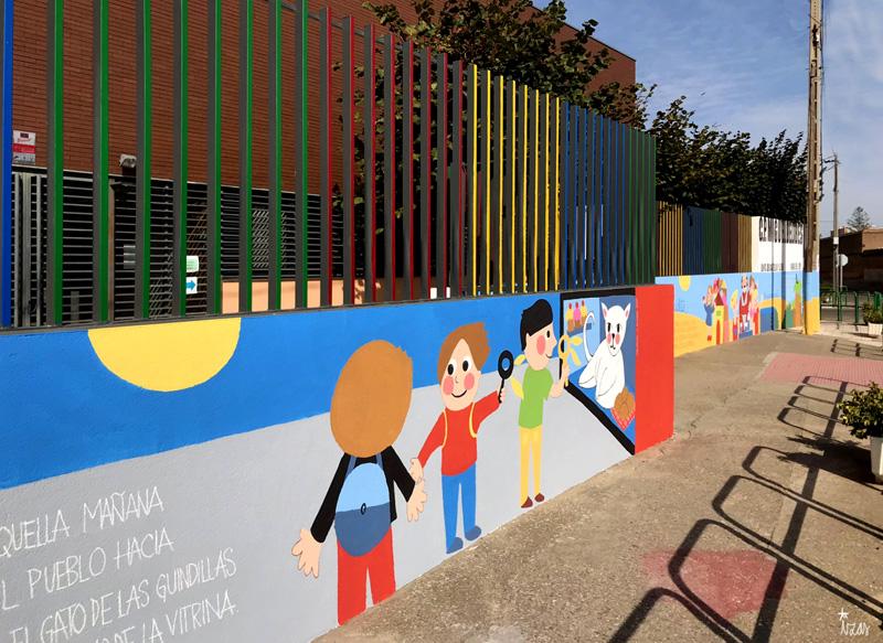 mural izas azulpatio dibujando la palabra ceip delibes izq 1
