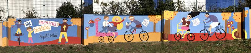 mural izas azulpatio dibujando la palabra cistierna montaje
