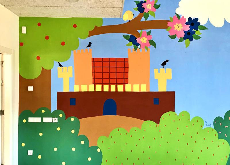 mural izas azulpatio dibujando la palabra cra los llanos detalle 1