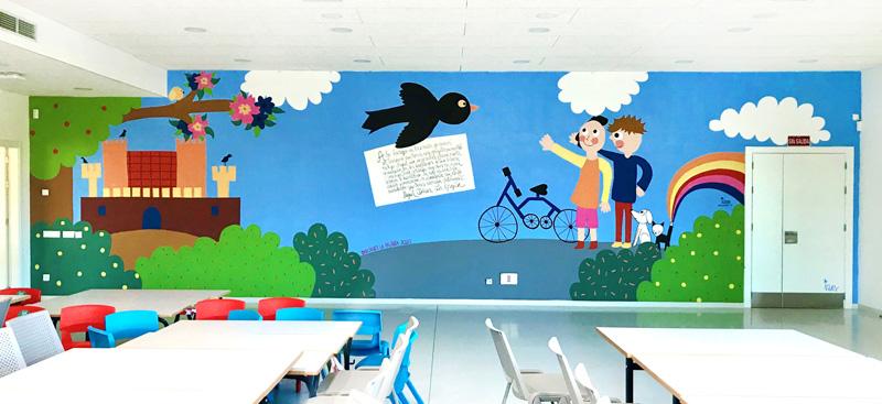 mural izas azulpatio dibujando la palabra cra los llanos pano