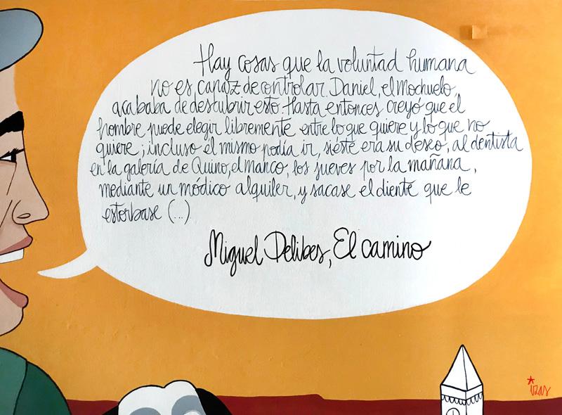 mural izas azulpatio dibujando la palabra madrigal texto