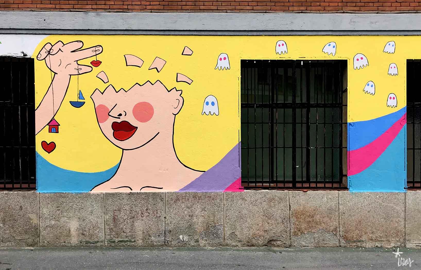 mural izas dibujando la palabra ávila 2