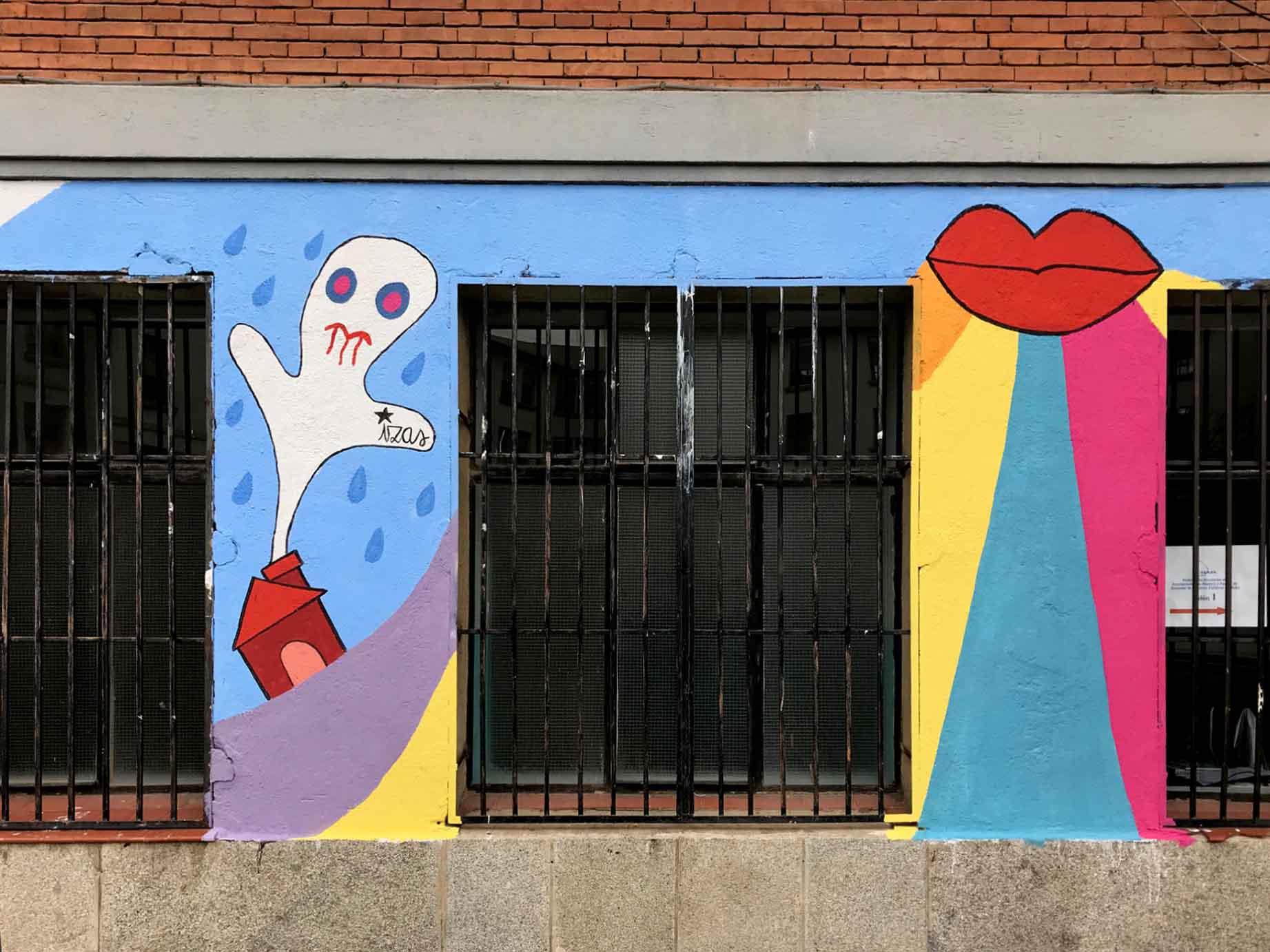 mural izas dibujando la palabra ávila 6