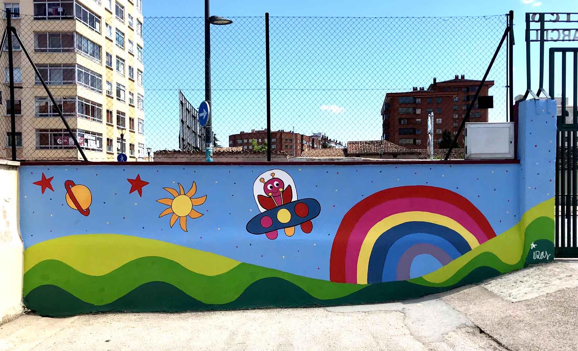 mural izas dibujando la palabra burgos 4