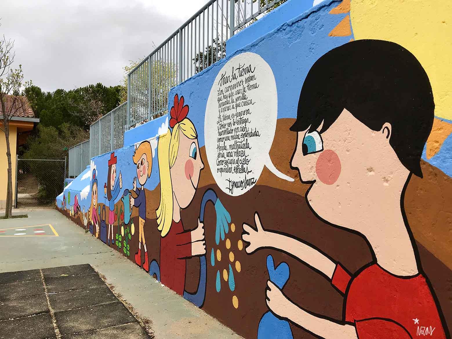 mural izas dibujando la palabra segovia 1