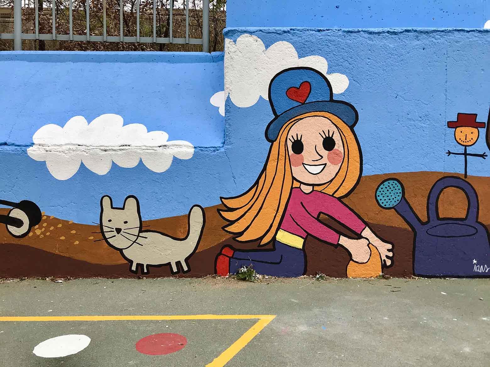 mural izas dibujando la palabra segovia 3