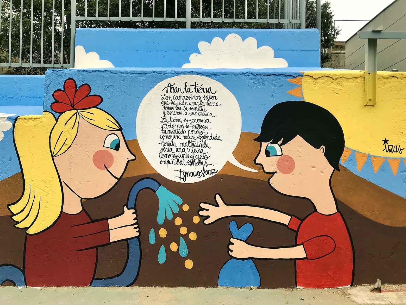 mural izas dibujando la palabra segovia 4