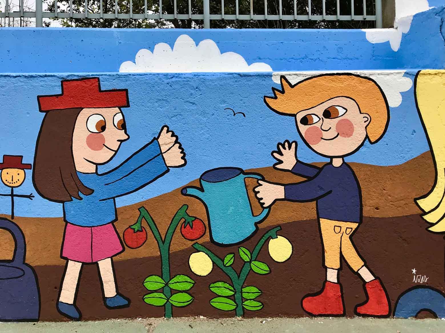 mural izas dibujando la palabra segovia 5