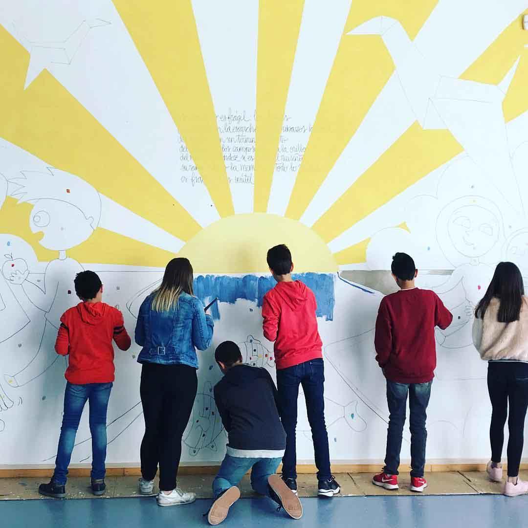 mural izas dibujando la palabra soria 3