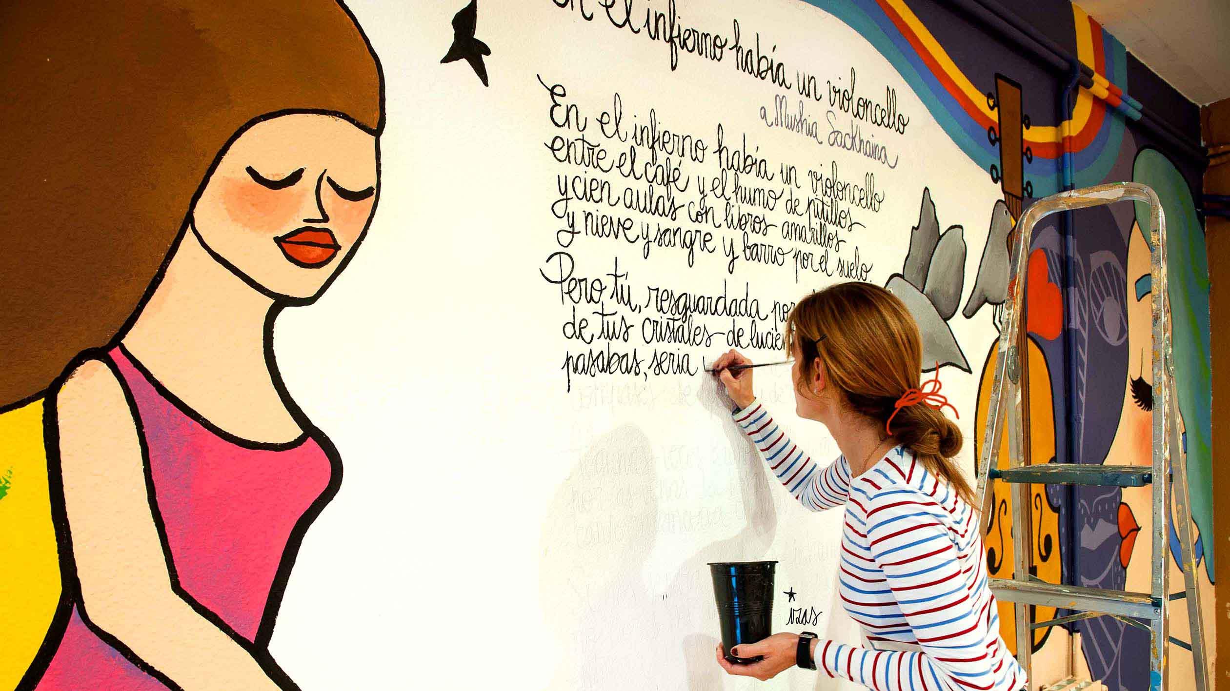 mural izas dibujando la palabra valladolid 3